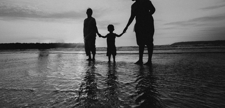 monochrome-photo-of-people-holding-hands-while-standing-on-4430320 (1)